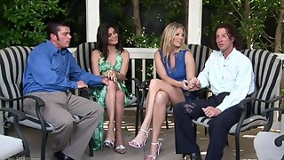 Horny ladies are fucked by two guys outdoors in a foursome