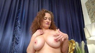 Chubby solo mature drops her clothes increased by plays almost her boobs