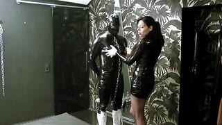 Lady ashley degrading and fucks 2 rubber slaves surrounding a human toilet