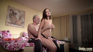 Young beauty Nastya is fucked by team a few seniors using viagra
